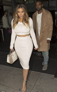 Kim Kardashian in her signature style crop top and below the knee length skirt